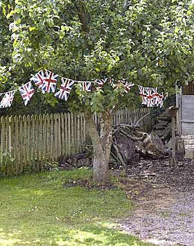 A string of flags decorate a tree in the village