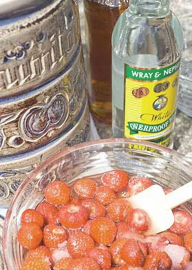 strawberries are the first layer of fruit to go into the rumtopf jar