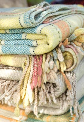 piles of blankets - it's time to wash them