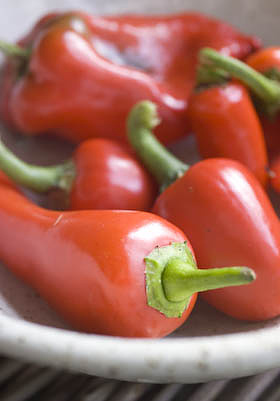 a selection of sweet red peppers and chillis