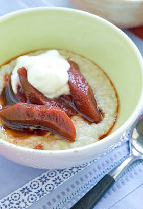 A bowl of oatmeal porridge with poached quince