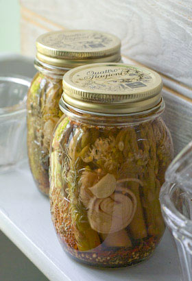 jars of pickled asparagus on pantry shelf