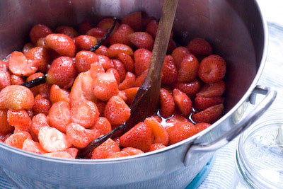 heating through the strawberries to release the syrup
