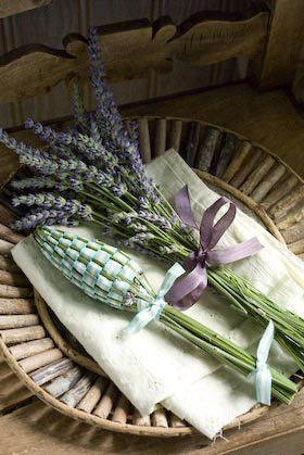 a lavender bottle woven with ribbon to scent the linen cupboard