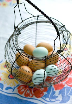 fresh eggs in a vintage French wire basket